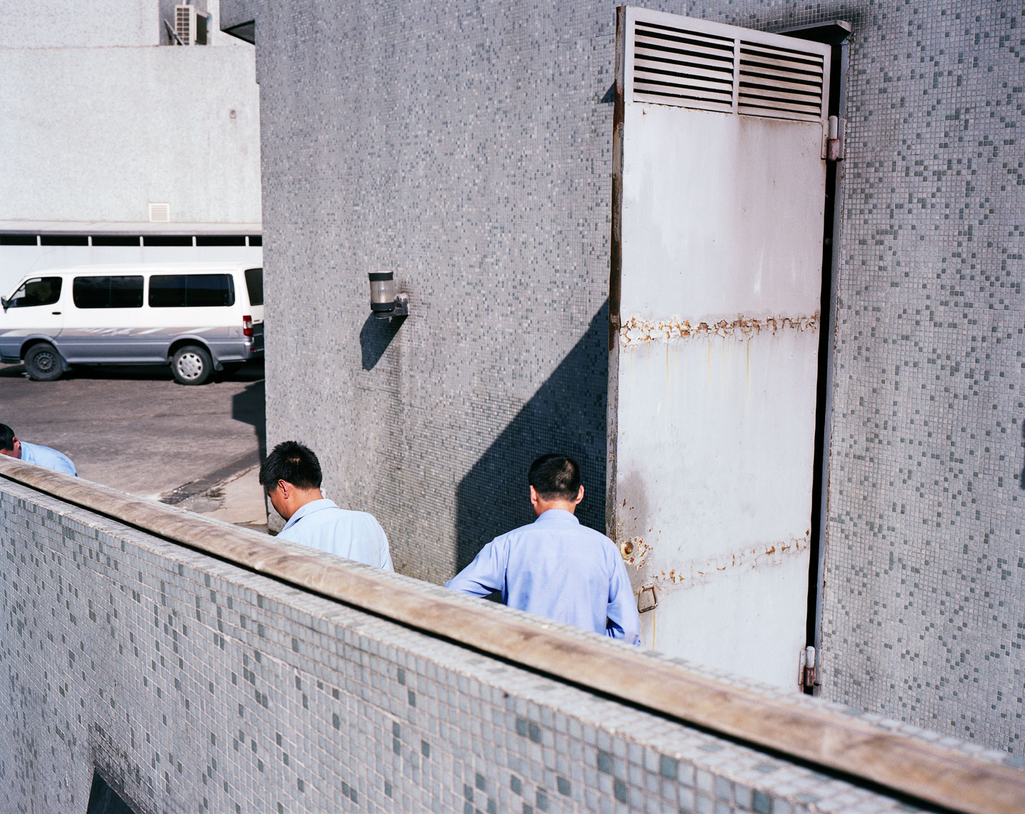 Men at door, 2009